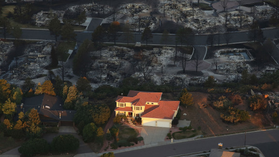 One home stands surrounded by others destroyed by the Waldo Canyon fire in Colorado Springs on Saturday.