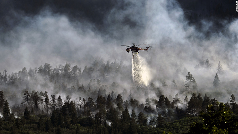 The fire, which has burned more than 15,000 acres, began spreading to the southwestern corner of the Air Force Academy in the early morning, causing base officials to evacuate residents.