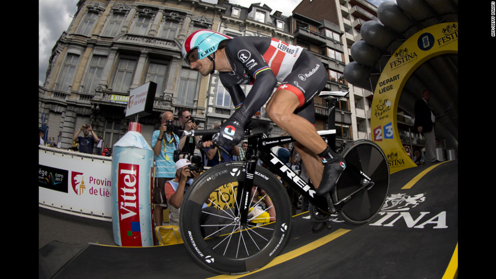 Fabian Cancellara of Switzerland lunges out of the starting gate for the individual time trial and first test in the 2012 Tour de France in Liege, Belgium, on Saturday, June 30.