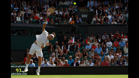 Ferrer, who is ranked fifth in the world, serves to Roddick, ranked 25th.