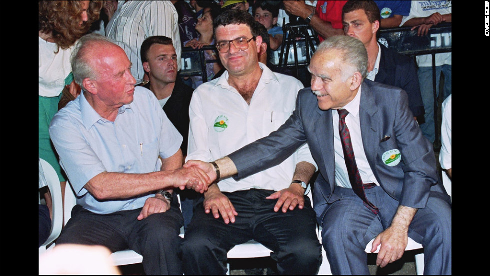 Shamir and Labor Party leader Yitzhak Rabin shake hands in Qatzerin on the Golan Heights  on June 10, 1992. The two candidates for prime minister were at an event commemorating the 25th anniversary of the capture of the Golan Heights from Syria.