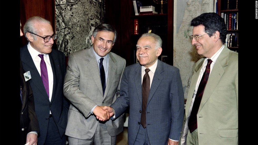 French foreign trade official Dominique Strauss-Kahn, center left, shakes hands with Shamir on May 27, 1992, in Jerusalem during an official visit.