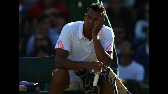 Jo-Wilfried Tsonga of France take a break during his third-round singles match against Lukas Lacko of Slovakia on Saturday.