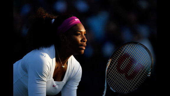 Serena Williams of the USA in action while playing with Venus Williams of the USA during their ladies