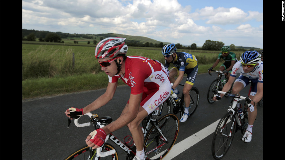A group of six riders, including Nicolas Edet of France, left, breaks away from the main group very early in Stage 1on Sunday. The riders were able to maintain a gap of several minutes until they were eventually caught about 8 kilometers (5 miles) from the finish line.