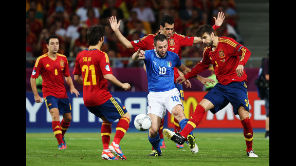 Antonio Cassano of Italy battles for the ball during the final match against Spain.