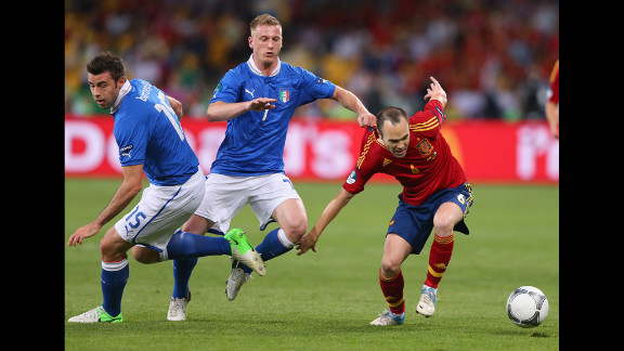 Ignazio Abate of Italy, center, grabs the shirt of Spain