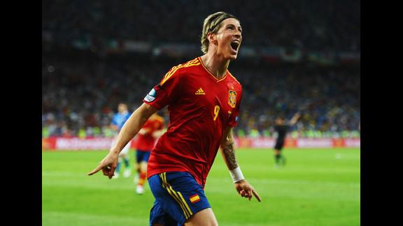 Fernando Torres of Spain celebrates scoring his team