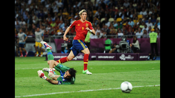 Gianluigi Buffon of Italy looks back at the ball as Spain