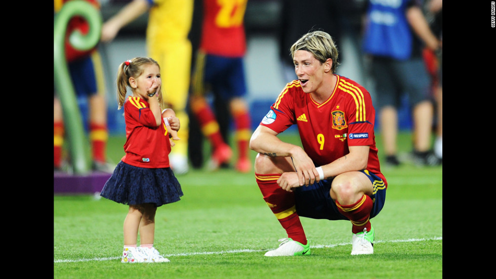 Fernando Torres of Spain speaks with his daughter, Nora, after Sunday's match against Italy.