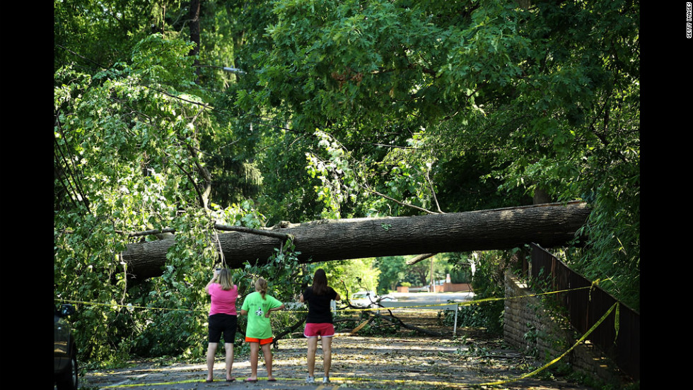 Local residents observe damages in Falls Church, Virginia.