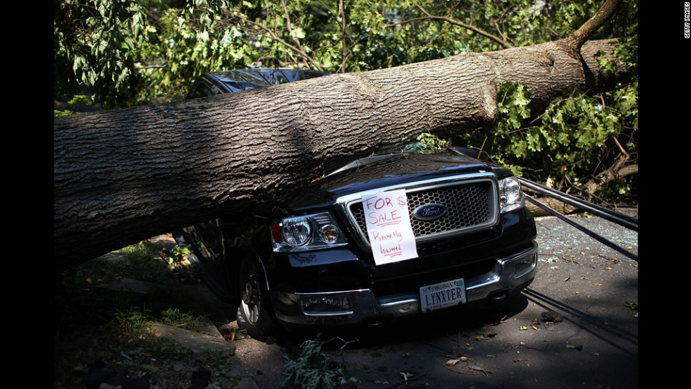 An owner left a note on his truck after it was damaged by a downed tree in Falls Church, Virginia.