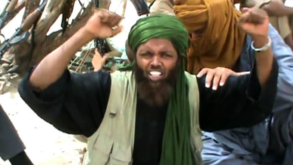 """An Islamist militant celebrates and shouts """"Allahu Akbar"""" (God is Greatest) after destroying an ancient shrine in Timbuktu."""