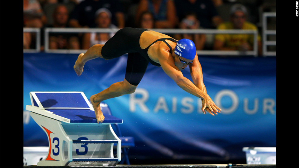 Torres, 45, dives off of the starting block as she competes in the second semifinal heat of the Women's 50-meter Freestyle during Day Seven of the 2012 U.S. Olympic Swimming Team Trials on Sunday, July 1.