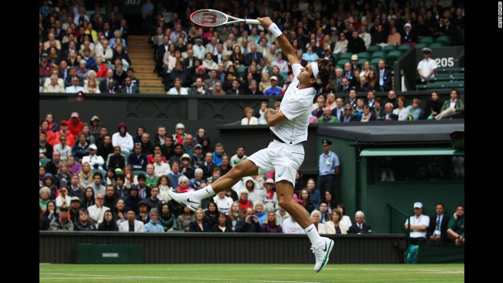 Roger Federer of Switzerland returns the ball to Xavier Malisse of Belgium during the fourth-round match at the Wimbledon championships in London on Monday.
