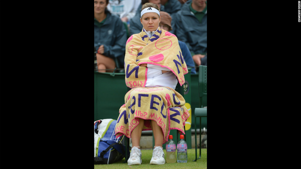 Russia's Maria Kirilenko keeps warm during a break in her match against China's Peng Shuai on Monday.