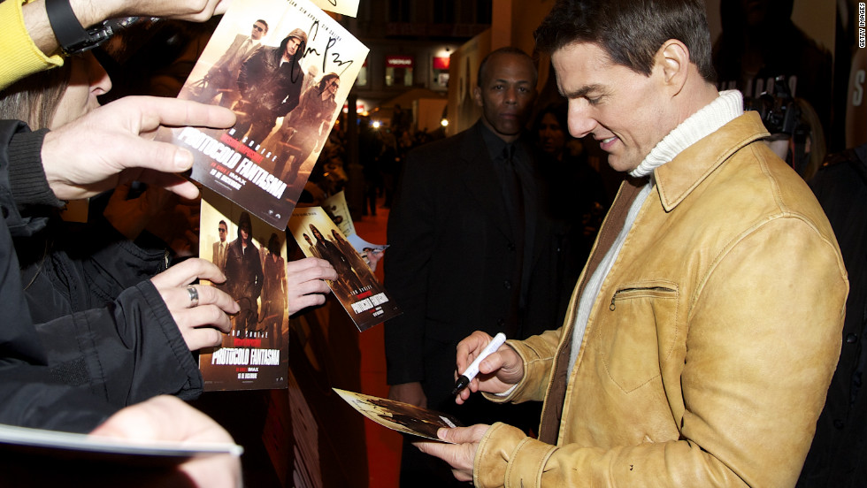 "Cruise greeted fans at the Madrid premiere of ""Mission Impossible -- Ghost Protocol"" in 2011."