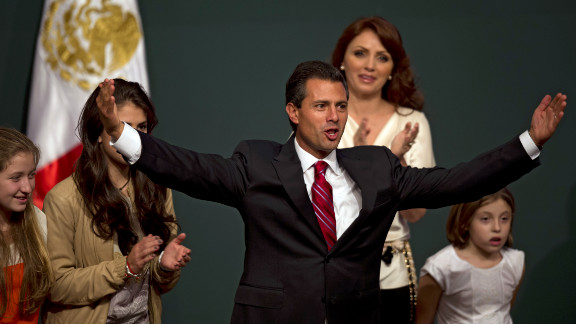 Peña Nieto celebrates with his family after projections declared him the apparent victor in Mexico's presidential election on Sunday, July 1.