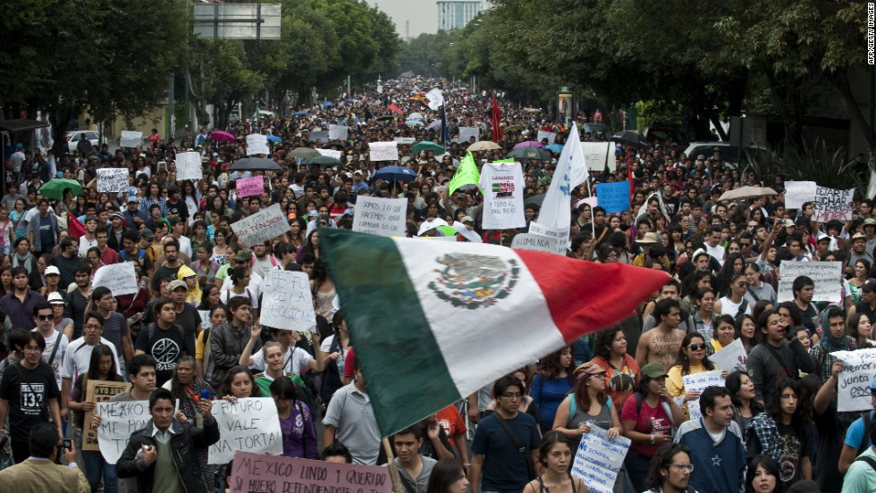 Thousands of protesters take to the streets in Mexico City on Monday, a day after the presidential election results were announced. Supporters of the opposition candidate were rallying against Enrique Peña Nieto, who declared victory late Sunday.