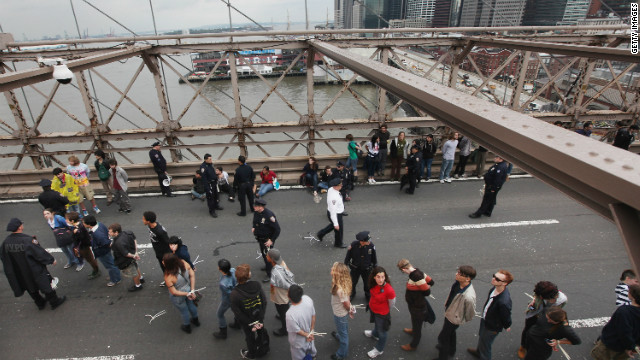 New York police lead away Occupy Wall Street protesters after they were arrested on the Brooklyn Bridge last October 1.