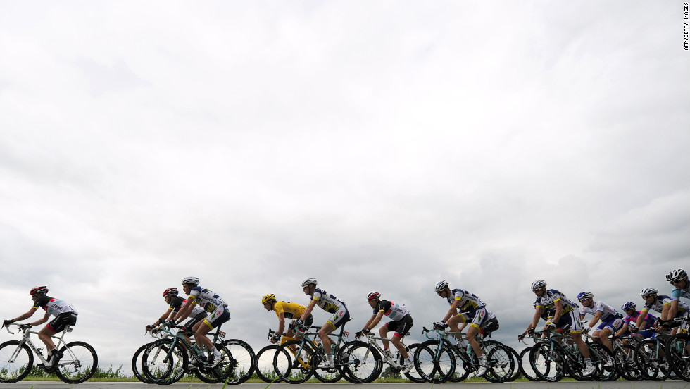 Overall race leader Fabian Cancellara of Switzerland, in yellow jersey, rides in the main group during Tuesday's 197-kilometer (122-mile) stage.