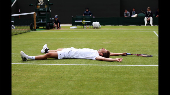 Florian Mayer of Germany celebrates match point during his men