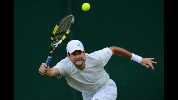 U.S. player Brian Baker plays a forehand shot during his fourth round men