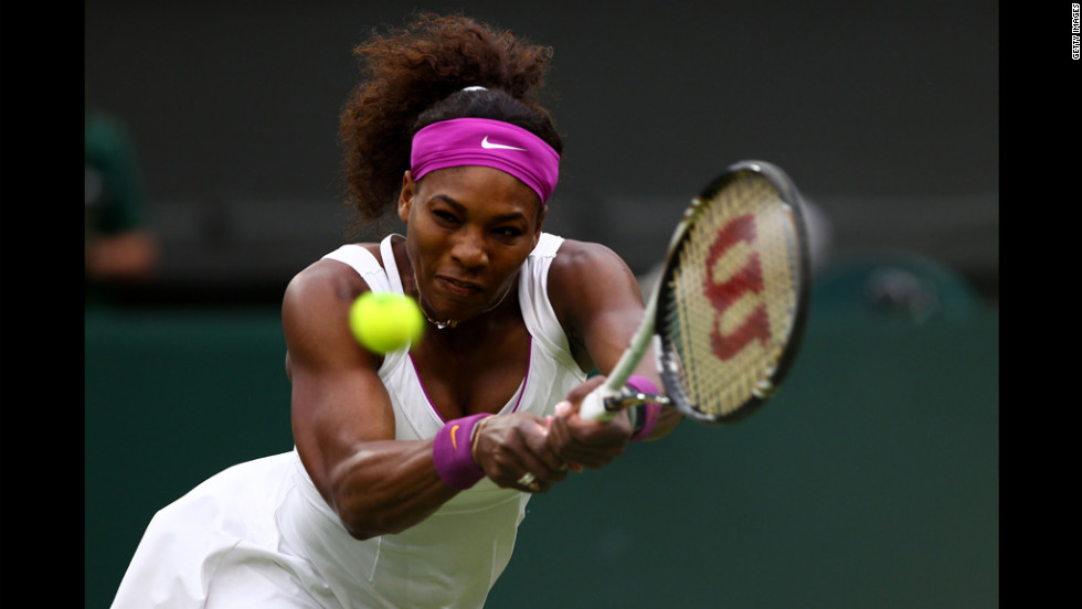 American Serena Williams returns a shot during her Ladies' Singles quarterfinal match against Petra Kvitova of the Czech Republic.