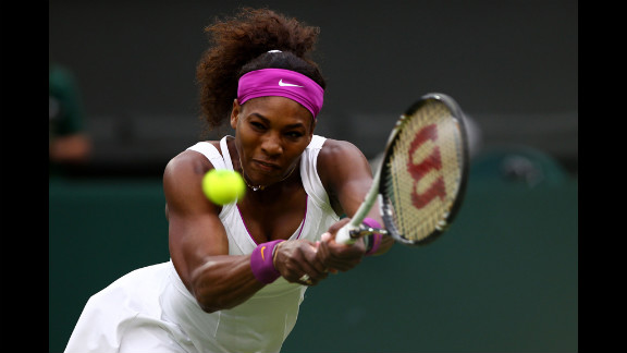 American Serena Williams returns a shot during her Ladies