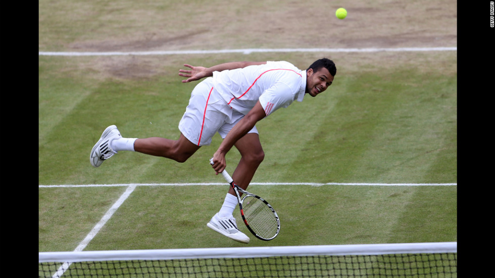 Jo-Wilfried Tsonga of France returns a shot during his Gentlemen's Singles fourth round match against  American Mardy Fish.