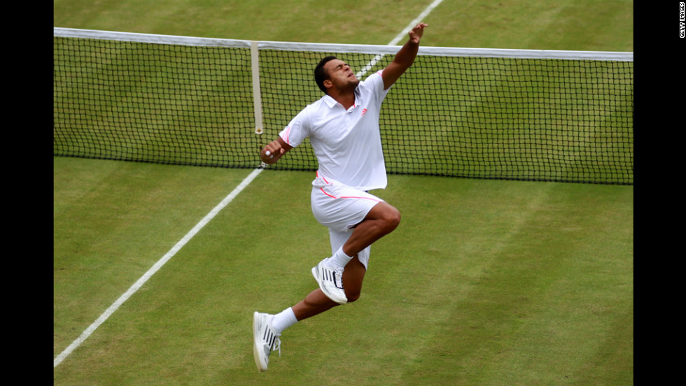 Tsonga celebrates after winning his fourth round match against Fish.