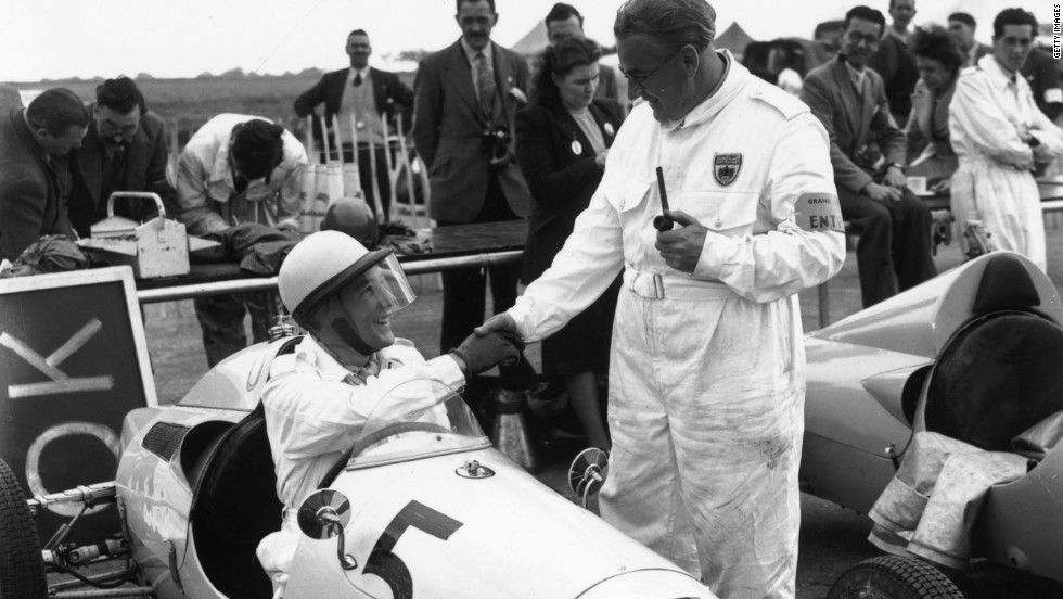 UK racing legend Stirling Moss, seen here talking to his father Alfred, competed at Silverstone as a 19-year-old that month.