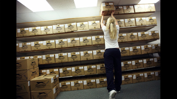 Boxes of tennis balls used for play during the Wimbledon championships are kept in a room at the All England Lawn Tennis Club in London.
