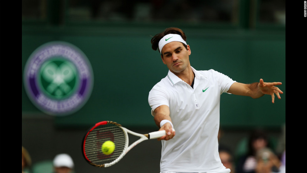 Roger Federer of Switzerland hits a forehand return during his men's singles quarterfinal match against Mikhail Youzhny of Russia on Wednesday.