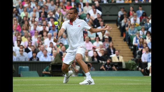 Mikhail Youzhny of Russia hits a backhand return during his men