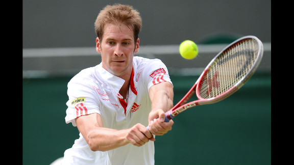 Mayer plays a double-handed backhand shot during his men