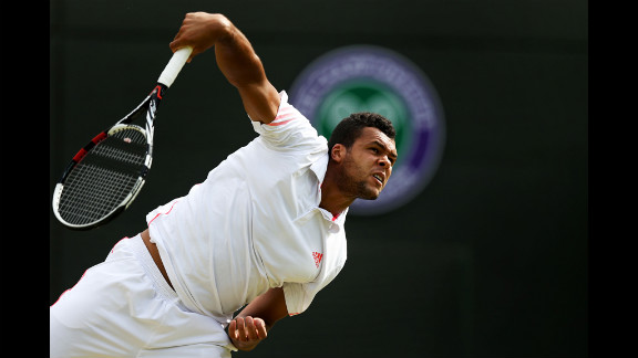 Tsonga of France serves against Kohlschreiber of Germany in this quarter final match.