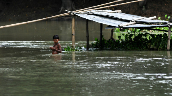 A child stands in floodwater in Naleni Village. More than 2,000 villages have been flooded.