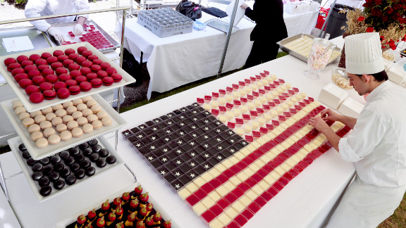 """Chefs prepare """"Stars and Stripes"""" desserts for a buffet at the U.S. Embassy in Paris on Wednesday."""