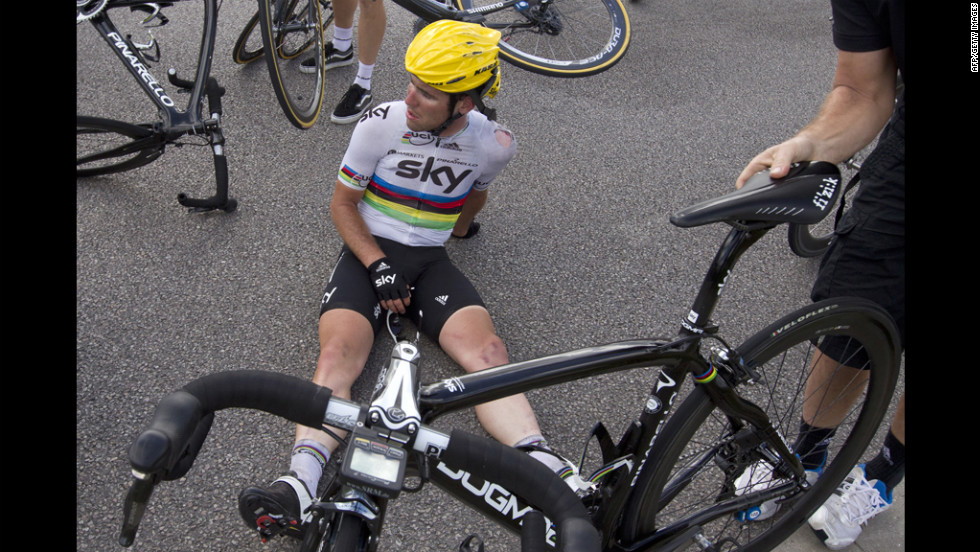 An injured Mark Cavendish of Great Britain sits on the pavement just after crashing near the end of the 214-kilometer Stage 4.
