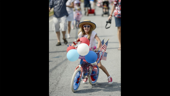 A girl rides her bicycle in the Fourth of July parade in Avondale Estates near Atlanta, Georgia.