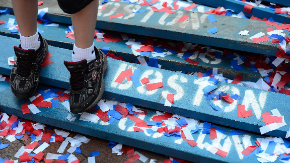 A child stands among red, white and blue confetti following the reading of the Declaration of Independence on Wednesday in Boston.