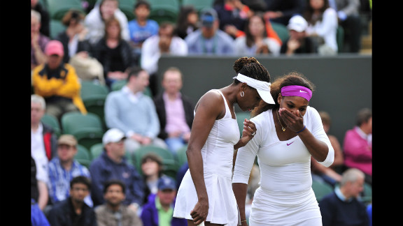 American Venus Williams confers with sister Serena, right, during their third round women