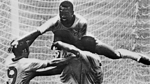 Pele (top) leaps on his teammates during Brazil
