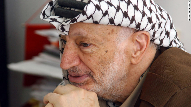 A file handout picture dated April 21, 2004 and made available by the Palestinian Press Office (PPO) shows Palestinian leader Yasser Arafat at his office in the West Bank city of Ramallah.
