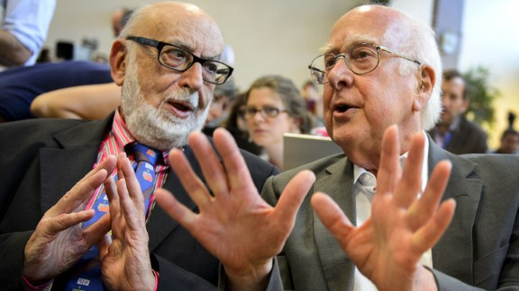 British physicist Peter Higgs, right, speaks with Belgian physicist Francois Englert at a press conference at Geneva's CERN facility in 2012. Higgs and Englert shared the 2013 Nobel Prize in Physics for describing an explanation for why particles have mass. They independently published papers on this topic in 1964.