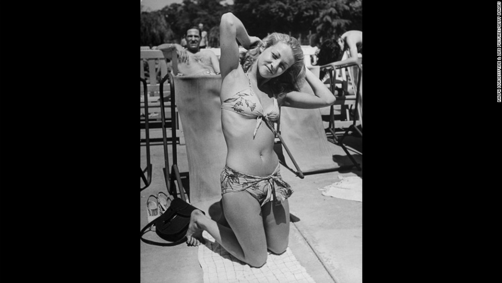 Although two-piece swimsuits -- like this one worn by a sunbather in France in 1945 -- had already been around for decades, a Frenchman named Louis Reard officially introduced the bikini on July 5, 1946. His idea was to fashion a garment, using as little fabric as possible, that could still be legally worn in public.