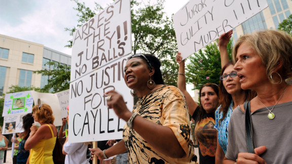 July 2011: The not-guilty charge divided many people who followed the case. Flora Reece, center, of Orlando is seen protesting the verdict outside the Orange County Courthouse.