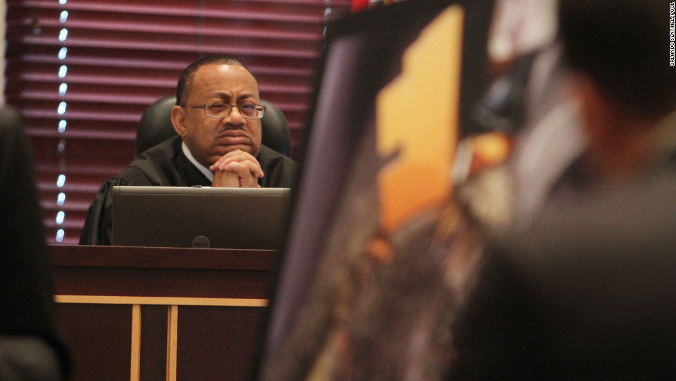 <strong>June 2011: </strong>Judge Belvin Perry looks at evidence as it's presented during the trial.