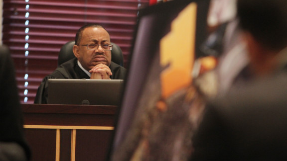 June 2011: Judge Belvin Perry looks at evidence as it's presented during the trial.